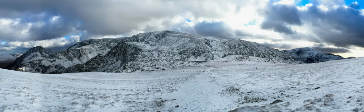 Landscape Photograph of the stunning snow covered mountain Glyder Fach