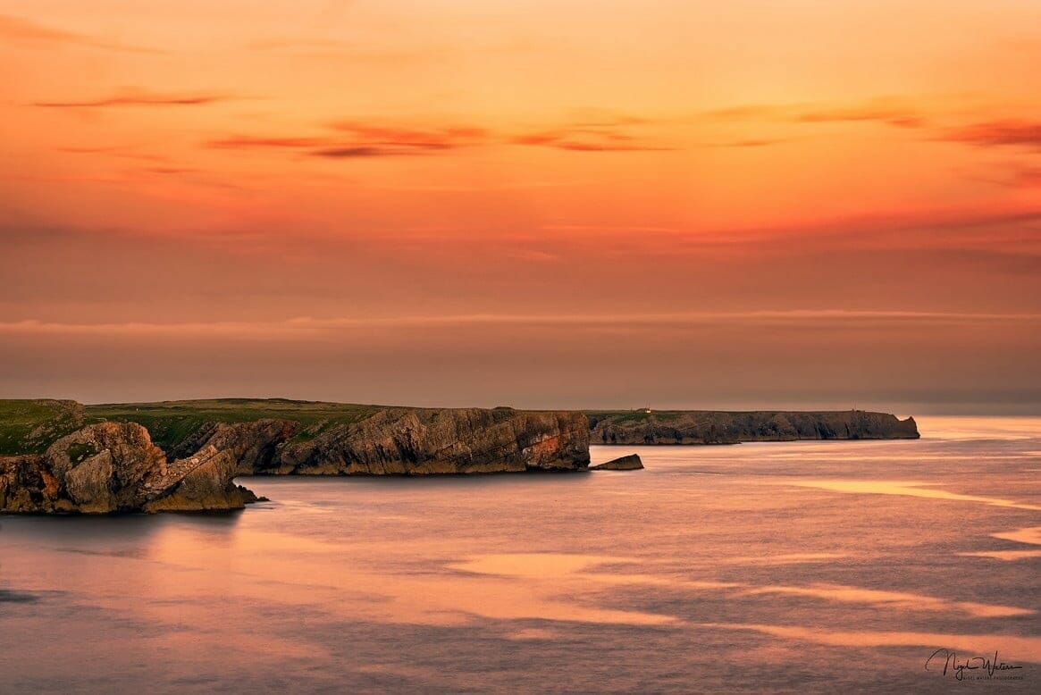 Three peninsulas Pembrokeshire coastal path at sunset in Wales