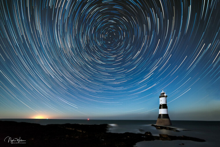 Star trails over Penmon Point Anglesey Wales