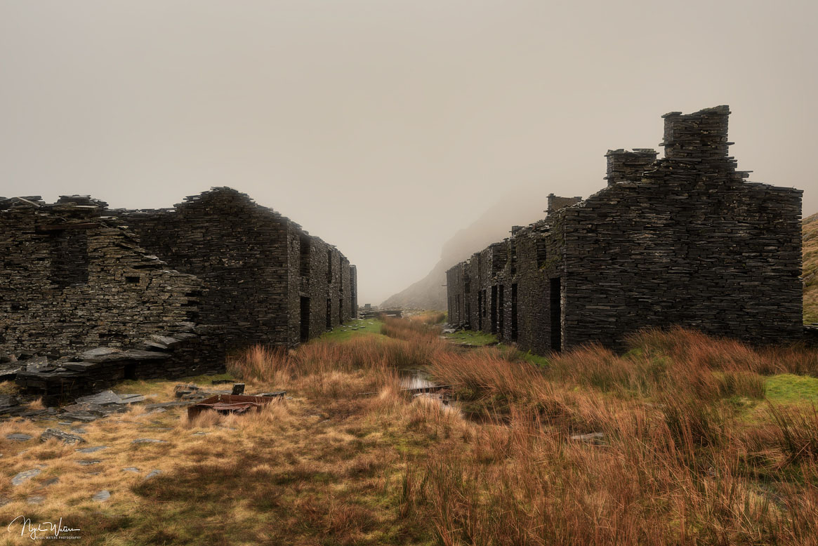 A different composition of the barracks with the stream leading from the bottom left of the frame.