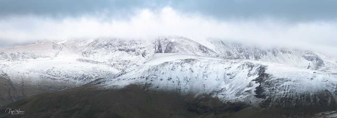 Wintery Mountain scene of the Snowdon Massif covered in snow